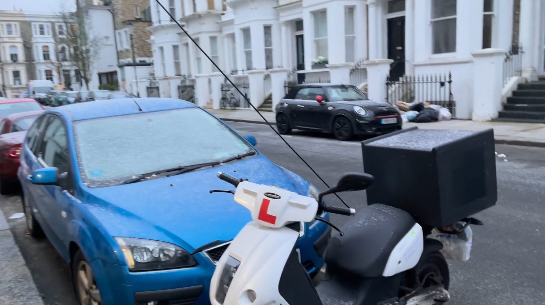 Solving the electric car on-street charging problem